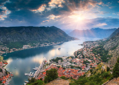 Panoramic landscape Kotor bay in Montenegro at sunset. Dramatic evening light. Balkans, Adriatic sea, Europe. View from the top of the mountain.