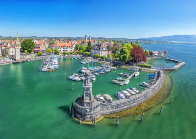 Harbor on Lake Constance with statue of lion at the entrance in Lindau, Bavaria, Germany