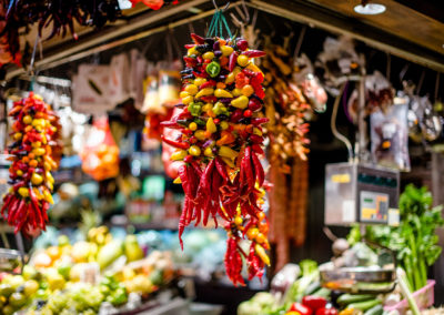 a bunch of hot peppers on the market in Spain