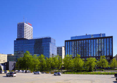 Warsaw, Masovia / Poland - 2018/04/22: Modernized office and commercial buildings of Warsaw city center at Marszalkowska street