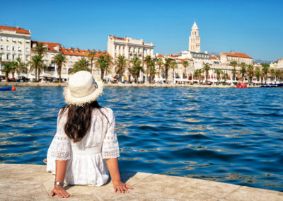 Woman traveler travel to old town of Split in Dalmatia, Croatia. Split is the famous city and top tourism destination of Croatia and Europe.
