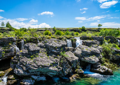 Montenegro, Many waterfalls flowing down rocky green scenery at niagara falls landmark in podgorica nature landscape with blue sky