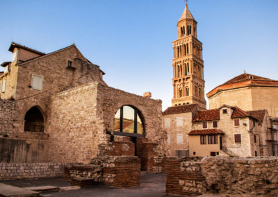 Scene from the old city of Split and the view of old bell tower in sunset