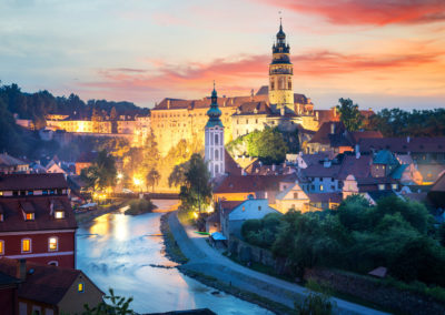 View over Cesky Krumlov with Moldau river at night, Czech Republic