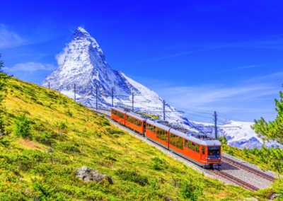 Zermatt, Switzerland. Gornergrat tourist train with Matterhorn mountain in the background. Valais region.