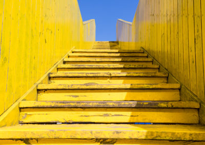 Yellow stairs of the wooden Luchtsingel bridge, Rotterdam, Netherlands with blue sky in summer