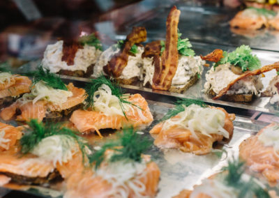 Selection of traditional open-faced Danish sandwiches,  smorrebrod, inside display case at a food market in Copenhagen, Denmark.